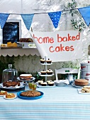 A cake buffet in front of a house