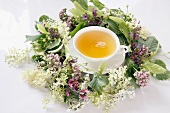 A wreath of flower and a cup of herbal tea
