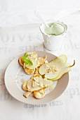 Vanilla pears with puff pastry biscuits and pistachio ice cream