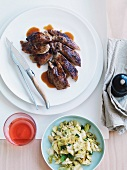 Braised duck with a savoy cabbage medley
