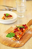 A slice of pizza on a wooden board