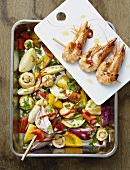 Oven-roasted vegetables with prawn kebabs