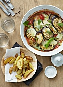 Aubergine bake and potato wedges