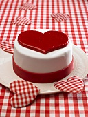 A red and white heart cake