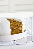Carrot cake decorated with cream cheese