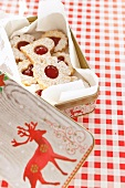 Jam biscuits in a Christmas biscuit tin