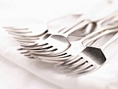 Silver Forks on a White Napkin