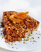 A tart made with dried fruit, nuts and caramel
