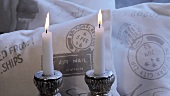 Two candles and decorative cushions