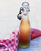 A bottle of apple syrup