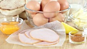 Ingredients for eggs Benedict (eggs, ham, English muffins)