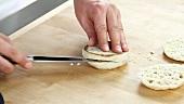 English muffins being halved