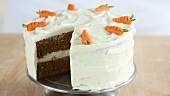 A sliced carrot cake with cream cheese frosting (USA)