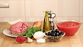 Ingredients for meatballs in tomato sauce