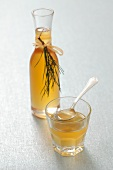 Pine syrup in a glass and a carafe