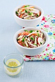 Carrot and courgette salad with radishes, bean sprouts, mayonnaise and mint