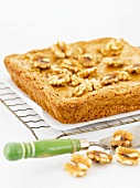Blonde Brownies Topped with Walnuts on a Cooling Rack