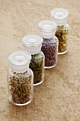 Various dried healing herbs in glass jars