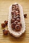 Medlars in a wooden bowl