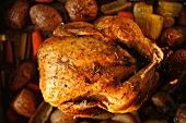 Whole Roasted Free Range Chicken with Herbs in a Pan with Organic Vegetables