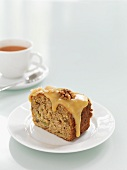 A slice of rhubarb, walnut and ginger cake