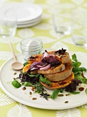 Mixed leaf salad with fried pumpkin, balsamic vinegar and onions