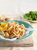 Squid rings with salt, pepper and lemon