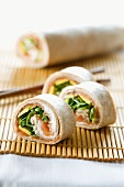Tortilla rolls filled with avocado and salmon