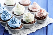 Chocolate cupcakes decorated with coloured cream
