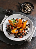 Roasted pumpkin on a bed of black beans with rice