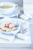 Bonbon-shaped shortbread biscuits with icing sugar and a mini sack of flour