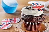 Chocolate cupcake topped with cream and a Union Jack