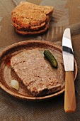 Goose liver terrine with gherkins and sliced bread