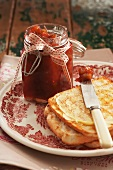 A jar of rhubarb jam and a slice of toast
