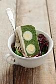 A spinach terrine with quail's eggs