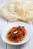 Tomato chutney and poppadoms (India)