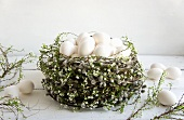 Pussy willow wreath filled with white eggs