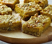 Pumpkin Dessert Bars on a Wooden Cutting Board