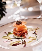 Salmon and Caviar Appetizer on a White Plate