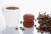 A cup of coffee and chocolate macaroons