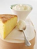 A slice of sponge cake with cream