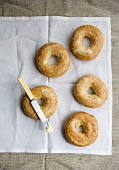 Five sesame seed bagels and a butter knife