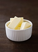 Pieces of butter in a small bowl