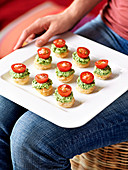Puff pastry canapes with feta cheese pesto and cherry tomatoes