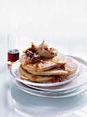 Cinnamon pancakes with maple syrup and candied walnuts