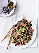 Shoulder of lamb with grapes, freekeh and parsley