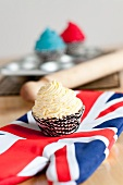A vanilla cupcake on a Union Jack