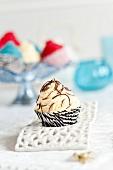 A cupcake in a paper case