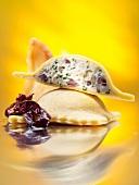 Cornflour ravioli filled with feta on braised radicchio with dried pears