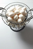 Organic White Eggs in a Wire Basket; From Above